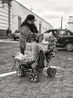Old lady selling on the street